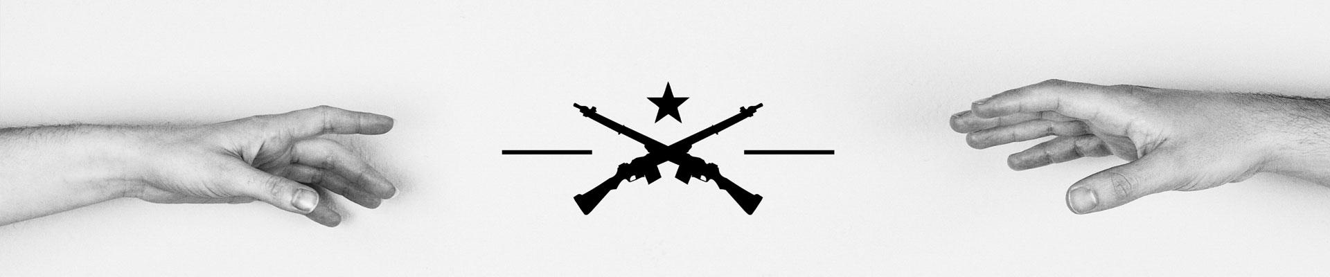 A black star symbol above two riffles crossing their barrels