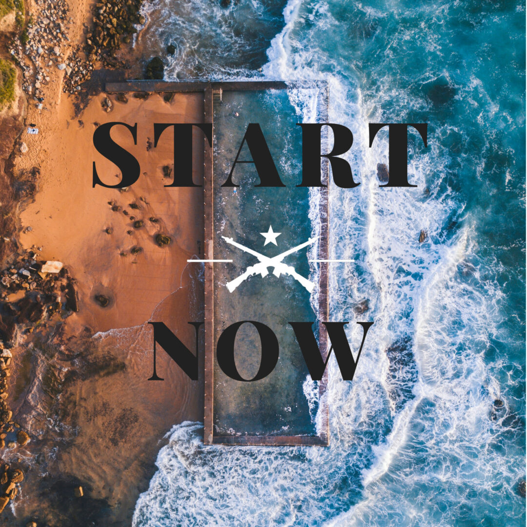 """Overhead shot of ocean waves crashing onto a red, sandy beach with the words """"Start Now"""" embossed in black text"""
